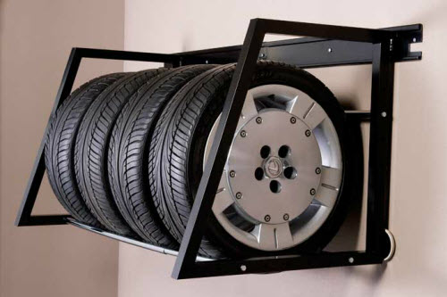 Use tire storage racks to get your spare tires off the floor and stored on the wall